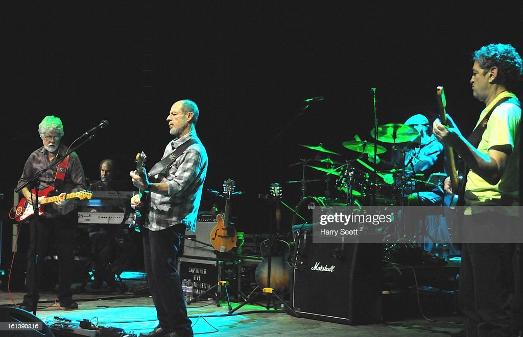 Fred Tackett, Bill Payne, Paul Barrere, Gabe Ford and Kenny Gradney of Little Feat perform on stage at Norwich UEA LCR on February 10, 2013 in Norwich, England.