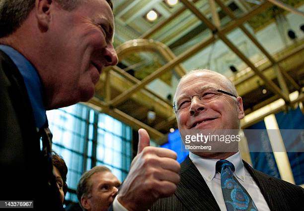 Fred Tomczyk chief executive officer of TD Ameritrade Holding Corp right gives a colleague the thumbs up sign on the trading floor of the New York...