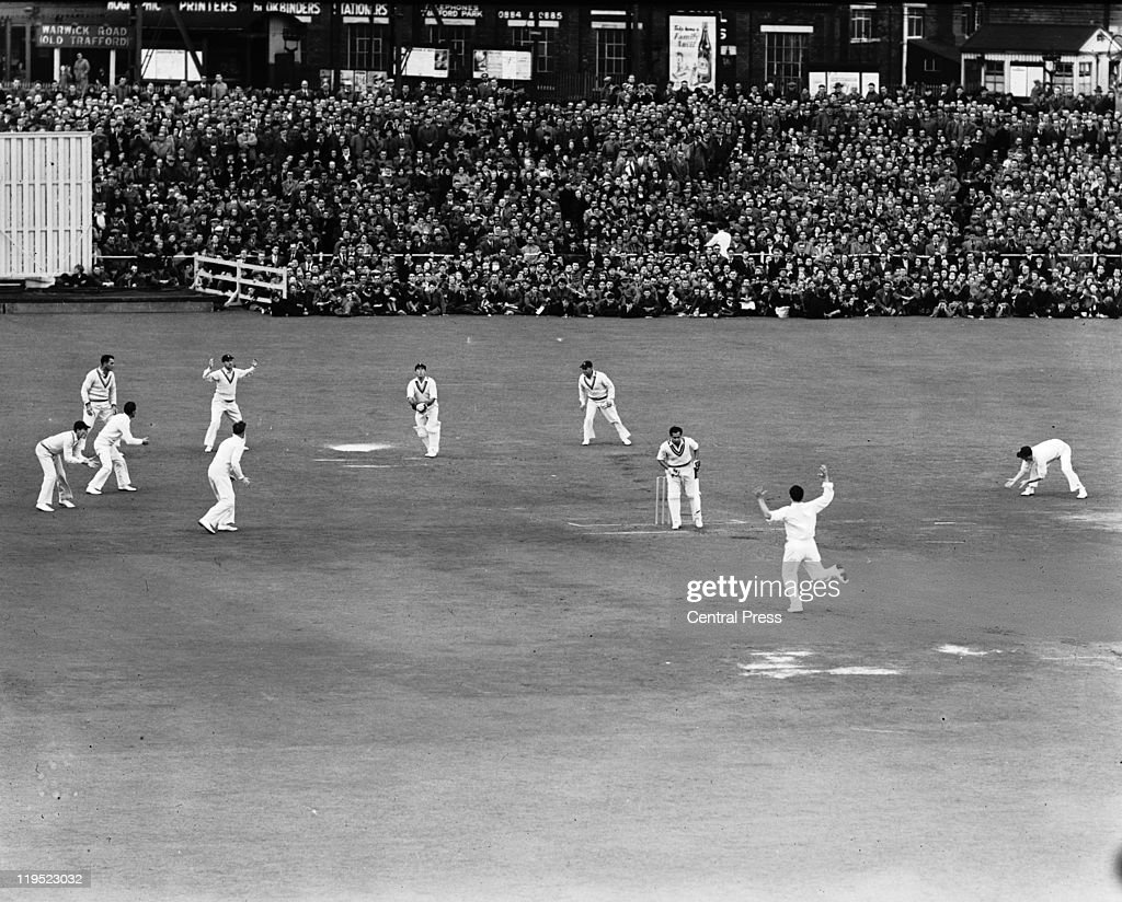 Fred Trueman bowls his final set for England in the Third Test against India at Old Trafford Manchester 19th July 1952 The batsman is Pankaj Roy