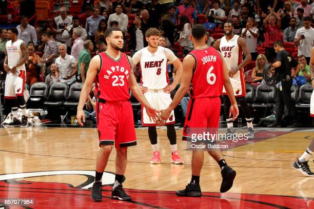 Fred VanVleet and Cory Joseph of the Toronto Raptors high five each other during the game against the Miami Heat on March 23 2017 at AmericanAirlines...