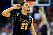 Fred VanVleet of the Wichita State Shockers celebrates as the second half ends against the Kansas Jayhawks during the third round of the 2015 NCAA...