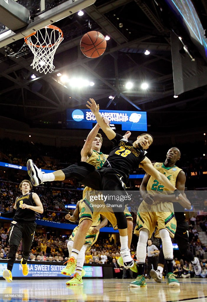 Fred VanVleet #23 of the Wichita State Shockers drives to the basket against Steve Vasturia #32 and Jerian Grant #22 of the Notre Dame Fighting Irish in the first half during the Midwest Regional semifinal of the 2015 NCAA Men's Basketball Tournament at Quicken Loans Arena on March 26, 2015 in Cleveland, Ohio.