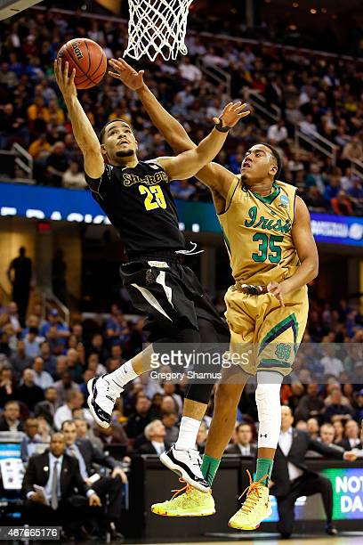 Fred VanVleet of the Wichita State Shockers drives to the basket against Bonzie Colson of the Notre Dame Fighting Irish in the first half during the...