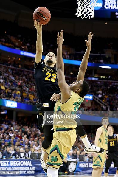 Fred VanVleet of the Wichita State Shockers drives to the basket against Bonzie Colson of the Notre Dame Fighting Irish in the second half during the...