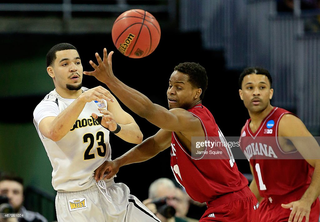 <a gi-track='captionPersonalityLinkClicked' href=/galleries/search?phrase=Fred+VanVleet&family=editorial&specificpeople=10612238 ng-click='$event.stopPropagation()'>Fred VanVleet</a> #23 of the Wichita State Shockers passes as <a gi-track='captionPersonalityLinkClicked' href=/galleries/search?phrase=Yogi+Ferrell&family=editorial&specificpeople=8023910 ng-click='$event.stopPropagation()'>Yogi Ferrell</a> #11 of the Indiana Hoosiers defends during the second round of the 2015 NCAA Men's Basketball Tournament at the CenturyLink Center on March 20, 2015 in Omaha, Nebraska.