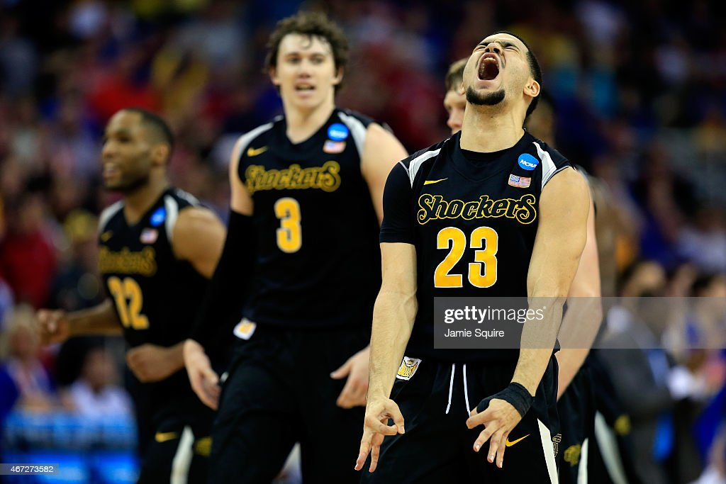 <a gi-track='captionPersonalityLinkClicked' href=/galleries/search?phrase=Fred+VanVleet&family=editorial&specificpeople=10612238 ng-click='$event.stopPropagation()'>Fred VanVleet</a> #23 of the Wichita State Shockers reacts after hitting a three-pointer against the Kansas Jayhawks in the first half during the third round of the 2015 NCAA Men's Basketball Tournament at the CenturyLink Center on March 22, 2015 in Omaha, Nebraska.