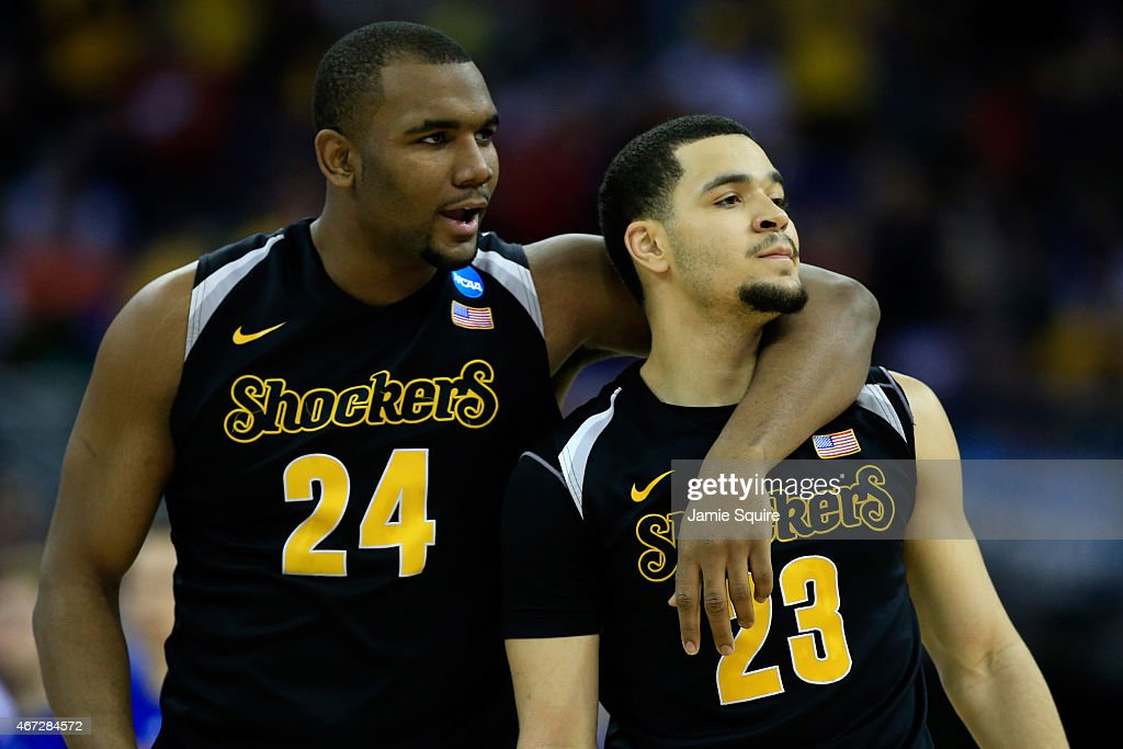 <a gi-track='captionPersonalityLinkClicked' href=/galleries/search?phrase=Fred+VanVleet&family=editorial&specificpeople=10612238 ng-click='$event.stopPropagation()'>Fred VanVleet</a> #23 of the Wichita State Shockers reacts with teammate Shaquille Morris #24 against the Kansas Jayhawks in the second half during the third round of the 2015 NCAA Men's Basketball Tournament at the CenturyLink Center on March 22, 2015 in Omaha, Nebraska.