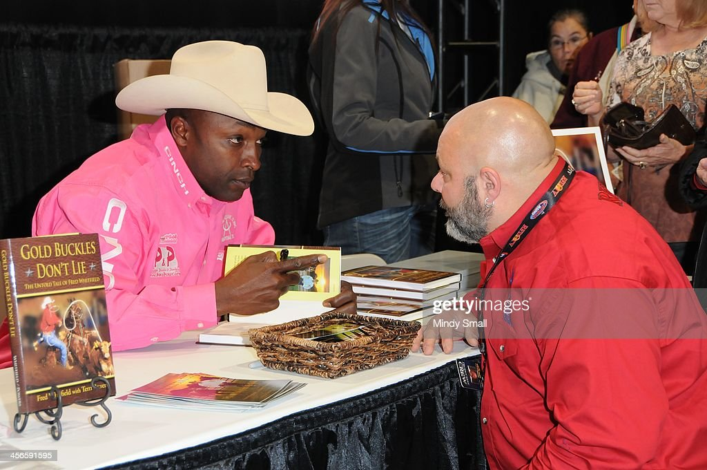 Fred Whitfield signs autographs at Cowboy FanFest during the Wrangler National Finals Rodeo at the on December 14, 2013 in Las Vegas, Nevada.
