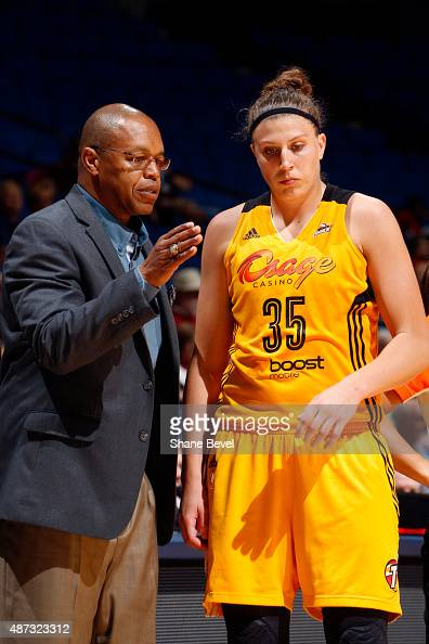 Fred Williams and Jordan Hooper of the Tulsa Shock talk during the game against the San Antonio Stars on September 8 2015 at the BOK Center in Tulsa...