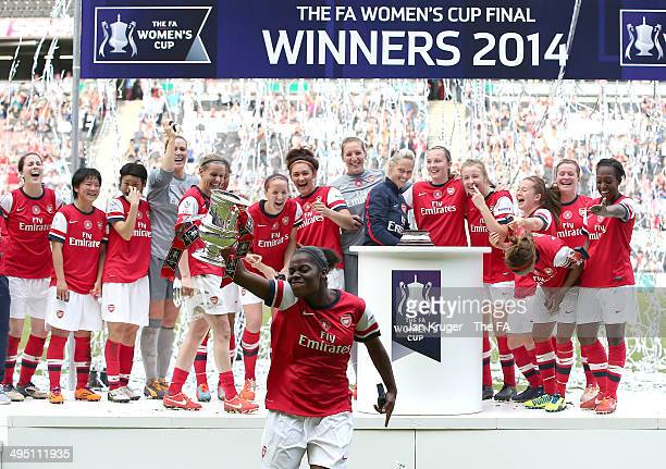 Freda Ayisi of Arsenal Ladies celebrate with the trophy during the FA Women's Cup final between Everton Ladies and Arsenal Ladies at Stadium mk on...