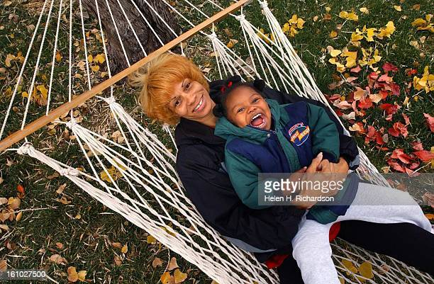 Freda Hancock swings in the hammock with her daughter Taya 2 at their home in Pueblo Hancock was a 9 time gold medal champion in track in High School...