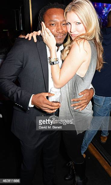 Freddie Achom and Caprice Bourret attend as Tinie Tempah performs at The Arts Club on February 5 2015 in London England