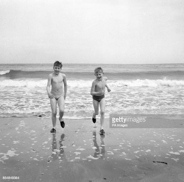 Freddie and Jayne Fearn enjoy their Cornish holiday as they buils sandcastles on the oilfree beach at St Ives Most of the beaches which suffered from...