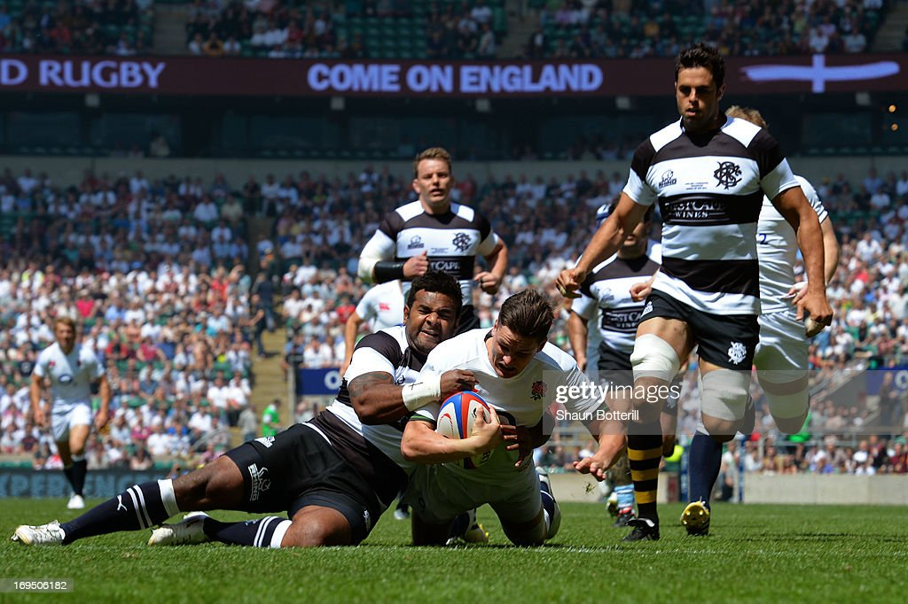 <a gi-track='captionPersonalityLinkClicked' href=/galleries/search?phrase=Freddie+Burns&family=editorial&specificpeople=5075956 ng-click='$event.stopPropagation()'>Freddie Burns</a> of England crashes through the tackle from <a gi-track='captionPersonalityLinkClicked' href=/galleries/search?phrase=Takudzwa+Ngwenya&family=editorial&specificpeople=4146910 ng-click='$event.stopPropagation()'>Takudzwa Ngwenya</a> of The Barbarians to score the opening try during the rugby union international match between England and The Barbarians at Twickenham Stadium on May 26, 2013 in London, England.