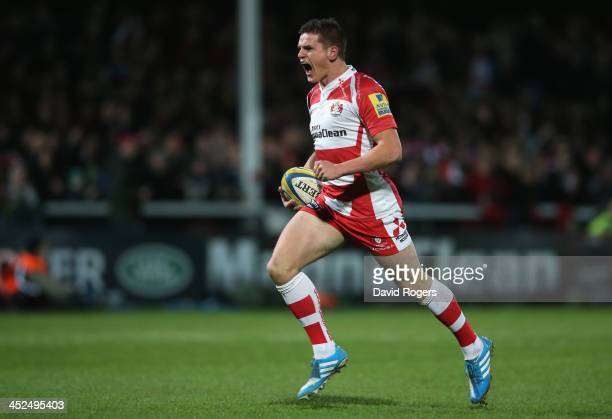 Freddie Burns of Gloucester breaks with the ball to score the first try during the Aviva Premiership match between Gloucester and Leicester Tigers at...