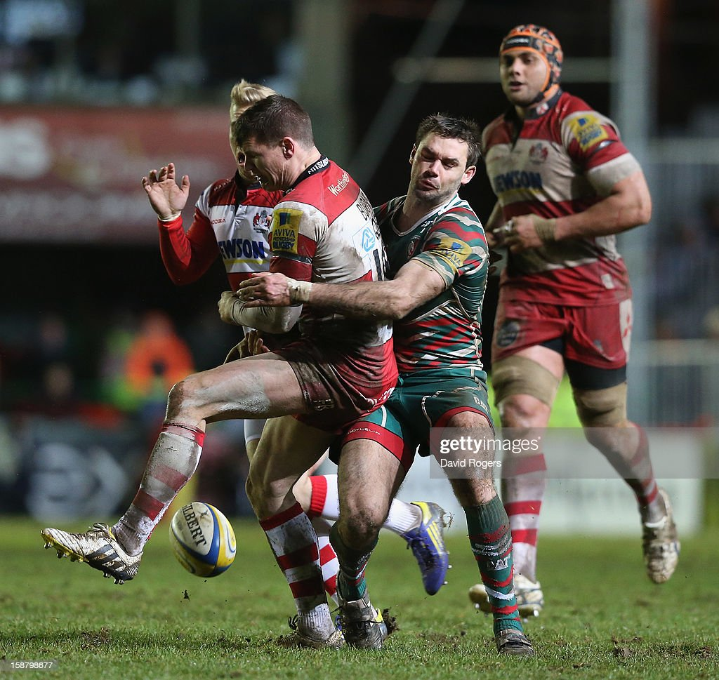 Freddie Burns of Gloucester is tackled by Niall Morris during the Aviva Premiership match between Leicester Tigers and Gloucester at Welford Road on December 29, 2012 in Leicester, England.