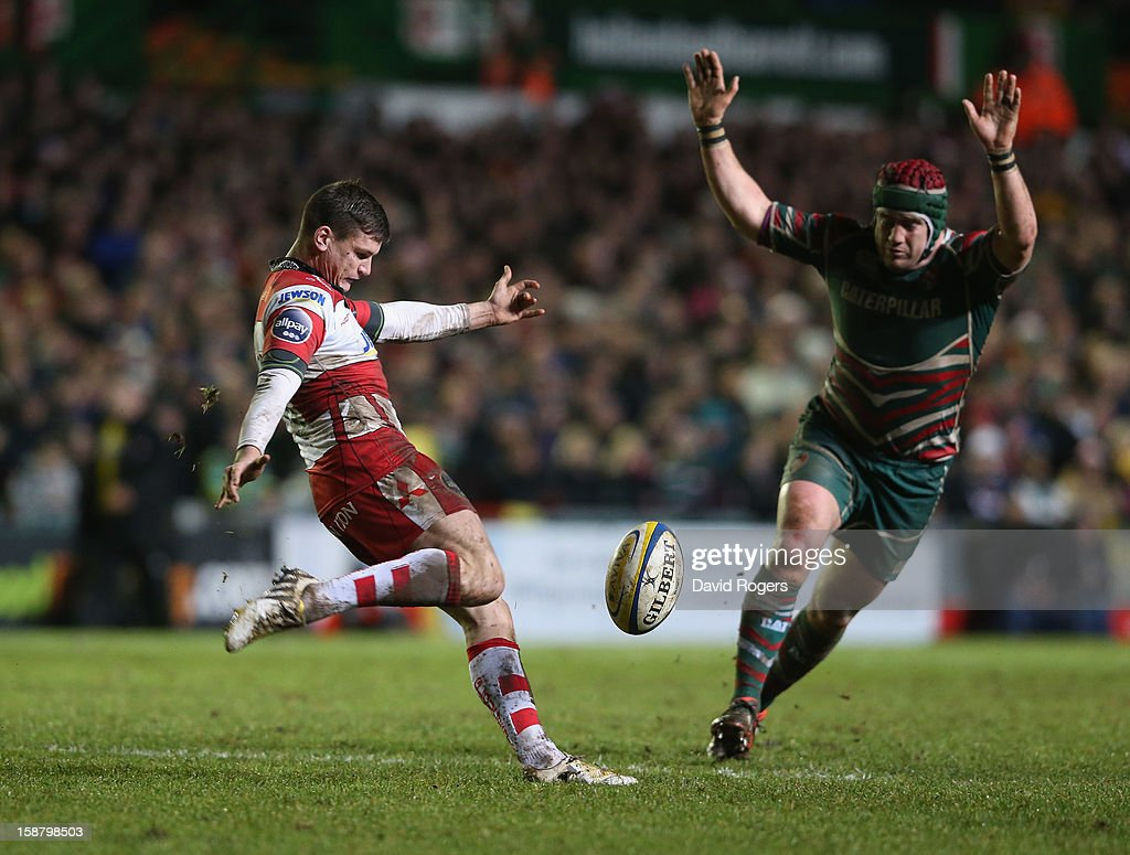 Freddie Burns of Gloucester kicks past <a gi-track='captionPersonalityLinkClicked' href=/galleries/search?phrase=Marcos+Ayerza&family=editorial&specificpeople=3034035 ng-click='$event.stopPropagation()'>Marcos Ayerza</a> during the Aviva Premiership match between Leicester Tigers and Gloucester at Welford Road on December 29, 2012 in Leicester, England.