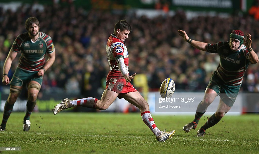 Freddie Burns of Gloucester kicks past Marcos Ayerza during the Aviva Premiership match between Leicester Tigers and Gloucester at Welford Road on December 29, 2012 in Leicester, England.