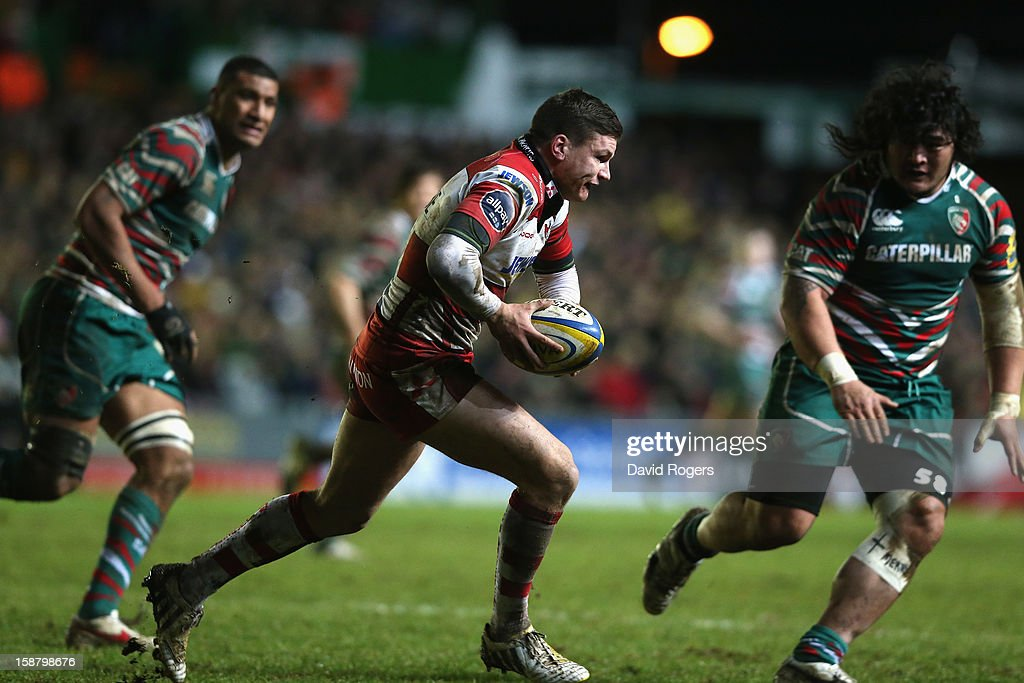 Freddie Burns of Gloucester runs with the ball upfield during the Aviva Premiership match between Leicester Tigers and Gloucester at Welford Road on December 29, 2012 in Leicester, England.