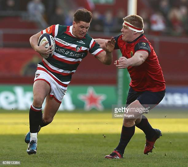 Freddie Burns of Leicester is tackled by John Ryan during the European Champions Cup match between Munster and Leicester Tigers at Thomond Park on...