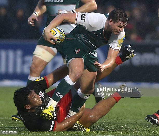 Freddie Burns of Leicester is tackled by Mako Vunipola during the Aviva Premiership match between Saracens and Leicester Tigers at Allianz Park on...