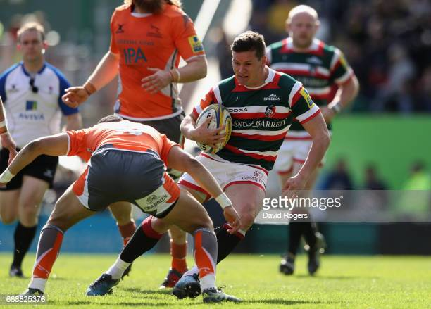 Freddie Burns of Leicester is tackled by Marcus Watson during the Aviva Premiership match between Leicester Tigers and Newcastle Falcons at Welford...
