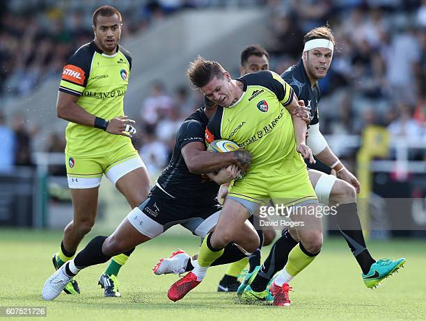 Freddie Burns of Leicester is tackled by Sonatane Takulua during the Aviva Premiership match between Newcastle Falcons and Leicester Tigers at...