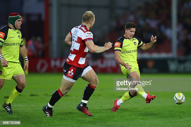Freddie Burns of Leicester kicks ahead as Matt Kvesic of Gloucester closes in during the Aviva Premiership match between Gloucester and Leicester...