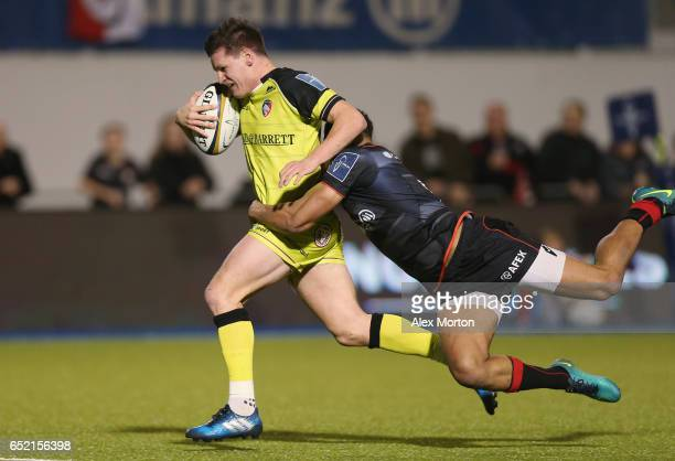 Freddie Burns of Leicester runs through to score their fourth try during the AngloWelsh Cup Semi Final match between Saracens and Leicester Tigers at...