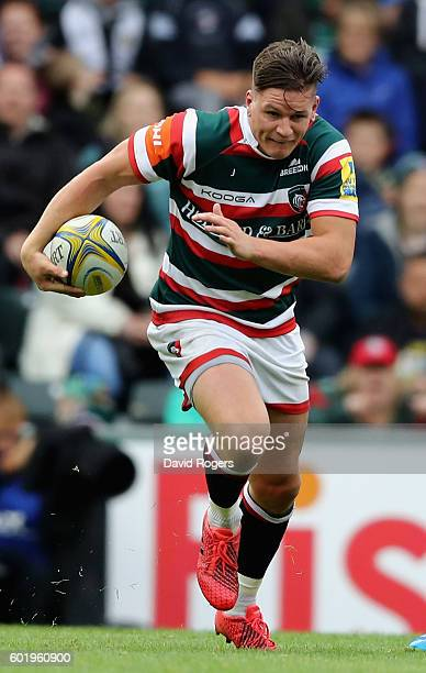 Freddie Burns of Leicester runs with the ball during the Aviva Premiership match between Leicester Tigers and Wasps at Welford Road on September 10...