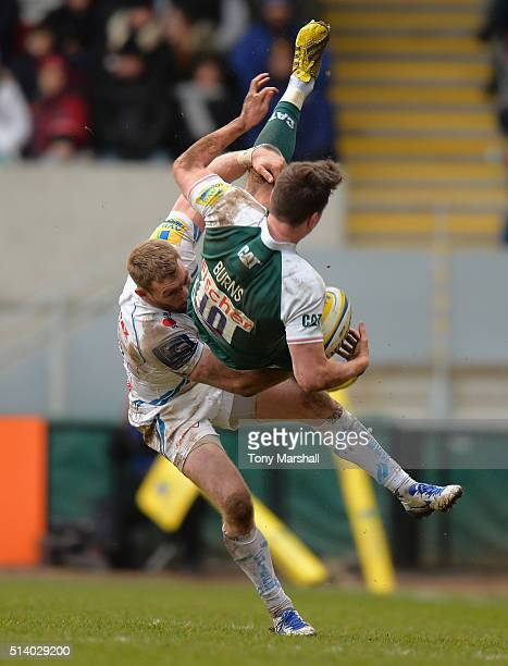 Freddie Burns of Leicester Tigers is tackled by Matt Jess of Exeter Chiefs during the Aviva Premiership match between Leicester Tigers and Exeter...