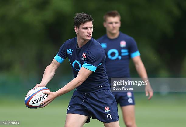 Freddie Burns passes the ball during the England training session held at the Lensbury Club on May 19 2014 in Teddington England