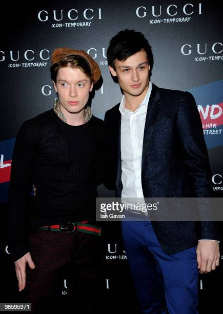 Freddie Fox and Douglas Booth attend the Gucci Icon Temporary store opening on April 21 2010 in London England