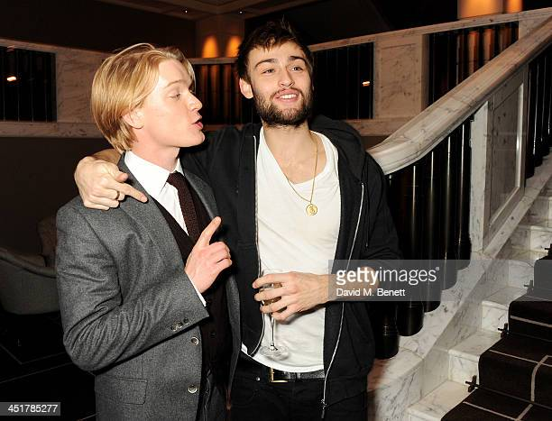 Freddie Fox and Douglas Booth attend The Old Vic's 24 Hour Celebrity Gala after party at Rosewood London on November 24 2013 in London United Kingdom