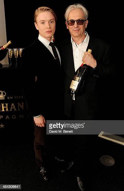Freddie Fox and Raindance founder Elliot Grove pose backstage at the Moet British Independent Film Awards 2013 at Old Billingsgate Market on December...
