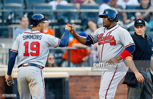 Freddie Freeman and Andrelton Simmons of the Atlanta Braves celebrates after both scored against the New York Mets in the eleventh inning at Citi...