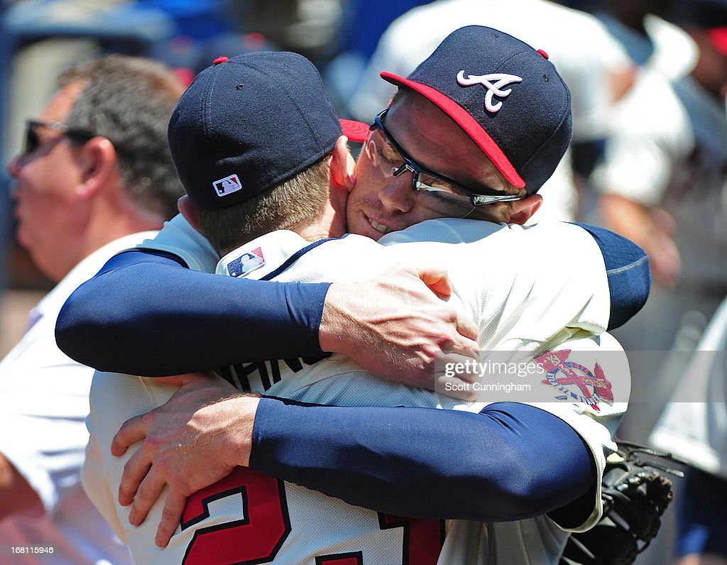 <a gi-track='captionPersonalityLinkClicked' href=/galleries/search?phrase=Freddie+Freeman&family=editorial&specificpeople=5743987 ng-click='$event.stopPropagation()'>Freddie Freeman</a> #5 and Chris Johnson #23 of the Atlanta Braves greet before the game against the New York Mets at Turner Field on May 5, 2013 in Atlanta, Georgia.