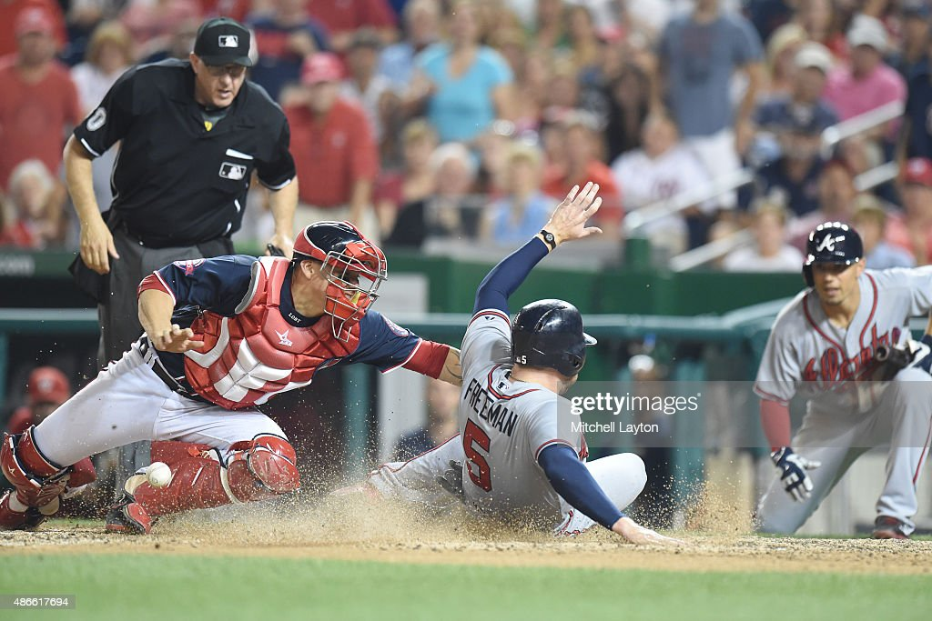 <a gi-track='captionPersonalityLinkClicked' href=/galleries/search?phrase=Freddie+Freeman&family=editorial&specificpeople=5743987 ng-click='$event.stopPropagation()'>Freddie Freeman</a> #5 of the Atlanta Braves beats tag from Jose Lobaton #59 of the Washington Nationals to tie the game in the eight inning on a Nick Swisher #23 (not pictured) hit during a baseball game at Nationals Park on September 4, 2015 in Washington, DC. The Nationals won 5-2 in the 10th inning.