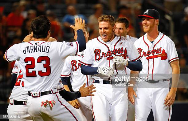 Freddie Freeman of the Atlanta Braves celebrates after his walkoff homer in their 54 win over the San Francisco Giants in the 11th inning at Turner...