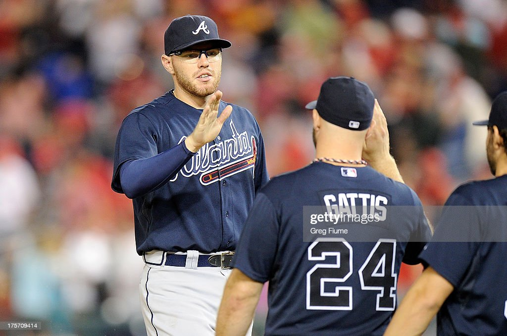 <a gi-track='captionPersonalityLinkClicked' href=/galleries/search?phrase=Freddie+Freeman&family=editorial&specificpeople=5743987 ng-click='$event.stopPropagation()'>Freddie Freeman</a> #5 of the Atlanta Braves celebrates with <a gi-track='captionPersonalityLinkClicked' href=/galleries/search?phrase=Evan+Gattis&family=editorial&specificpeople=8977937 ng-click='$event.stopPropagation()'>Evan Gattis</a> #24 after a 2-1 victory against the Washington Nationals at Nationals Park on August 6, 2013 in Washington, DC.