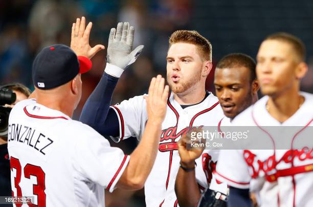 Freddie Freeman of the Atlanta Braves celebrates with manager Fredi Gonzalez after hitting a gamewinning RBI single in the bottom of the 10th inning...
