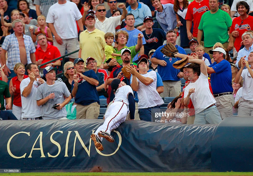 <a gi-track='captionPersonalityLinkClicked' href=/galleries/search?phrase=Freddie+Freeman&family=editorial&specificpeople=5743987 ng-click='$event.stopPropagation()'>Freddie Freeman</a> #5 of the Atlanta Braves dives into the first row to catch a pop fly foul ball by Pablo Sandoval #48 of the San Francisco Giants at Turner Field on August 18, 2011 in Atlanta, Georgia.