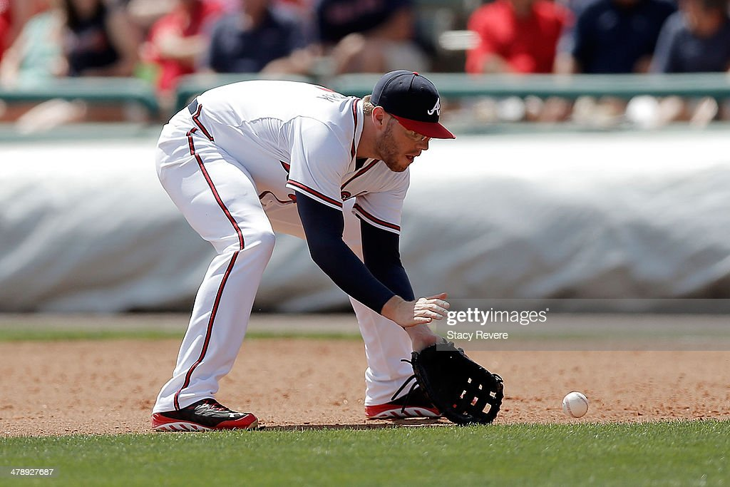 <a gi-track='captionPersonalityLinkClicked' href=/galleries/search?phrase=Freddie+Freeman&family=editorial&specificpeople=5743987 ng-click='$event.stopPropagation()'>Freddie Freeman</a> #5 of the Atlanta Braves fields a ground ball in the fourth inning of a game against the St. Louis Cardinals at Champion Stadium on March 15, 2014 in Lake Buena Vista, Florida. St. Louis won the game 6-2.