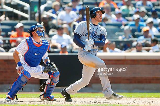Freddie Freeman of the Atlanta Braves follows through on a seventh inning RBI double against the New York Mets at Citi Field on June 19 2016 in the...