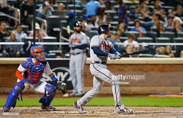 Freddie Freeman of the Atlanta Braves follows through on a third inning home run against the New York Mets at Citi Field on September 19 2016 in the...