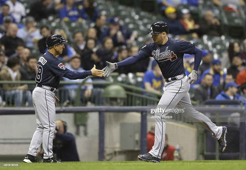 <a gi-track='captionPersonalityLinkClicked' href=/galleries/search?phrase=Freddie+Freeman&family=editorial&specificpeople=5743987 ng-click='$event.stopPropagation()'>Freddie Freeman</a> #5 of the Atlanta Braves gets congratulated by third base coach Doug Dascenzo after his home run against the Milwaukee Brewers in the eighth inning of a game at Miller Park on April 1, 2014 in Milwaukee, Wisconsin.