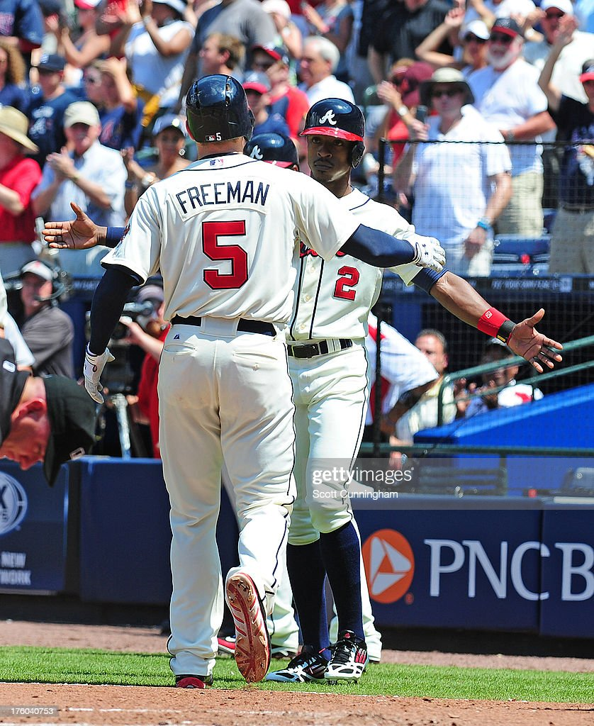 <a gi-track='captionPersonalityLinkClicked' href=/galleries/search?phrase=Freddie+Freeman&family=editorial&specificpeople=5743987 ng-click='$event.stopPropagation()'>Freddie Freeman</a> #5 of the Atlanta Braves is congratulated by B. J. Upton #2 after hitting a three run home run in the fifth inning against the Miami Marlins at Turner Field on August 11, 2013 in Atlanta, Georgia.