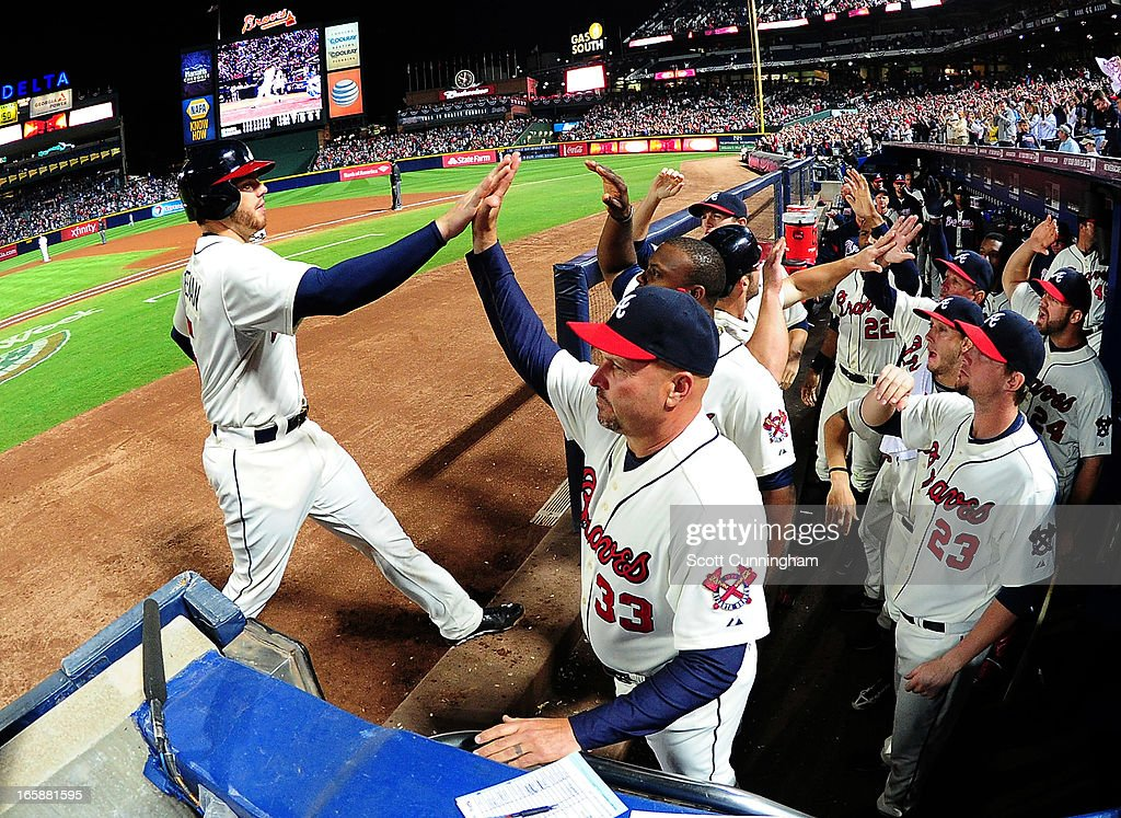 <a gi-track='captionPersonalityLinkClicked' href=/galleries/search?phrase=Freddie+Freeman&family=editorial&specificpeople=5743987 ng-click='$event.stopPropagation()'>Freddie Freeman</a> #5 of the Atlanta Braves is congratulated by Manager <a gi-track='captionPersonalityLinkClicked' href=/galleries/search?phrase=Fredi+Gonzalez&family=editorial&specificpeople=686896 ng-click='$event.stopPropagation()'>Fredi Gonzalez</a> #33 after scoring an eighth inning run against the Chicago Cubs at Turner Field on April 6, 2013 in Atlanta, Georgia.