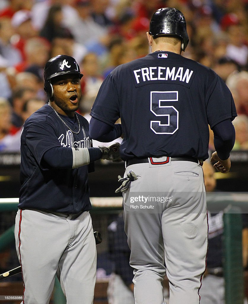 Freddie Freeman #5 of the Atlanta Braves is congratulated by teammate <a gi-track='captionPersonalityLinkClicked' href=/galleries/search?phrase=Jose+Constanza&family=editorial&specificpeople=7471312 ng-click='$event.stopPropagation()'>Jose Constanza</a> #13 after scoring on a ground ball by Brian McCann in the second inning during a MLB baseball game on September 21, 2012 at Citizens Bank Park in Philadelphia, Pennsylvania.