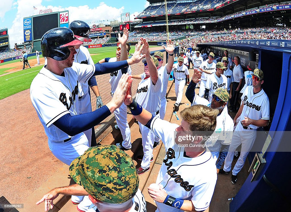 <a gi-track='captionPersonalityLinkClicked' href=/galleries/search?phrase=Freddie+Freeman&family=editorial&specificpeople=5743987 ng-click='$event.stopPropagation()'>Freddie Freeman</a> #5 of the Atlanta Braves is congratulated by teammates after scoring a third inning run against the San Francisco Giants at Turner Field on May 30, 2016 in Atlanta, Georgia.